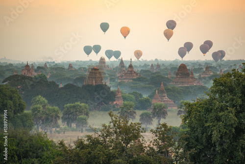 Hot air balloon over ancient pagoda in Bagan, Myanmar Poster