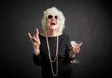 Cool grandmother with sunglasses and drink in hand - 139053301