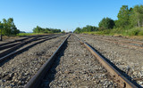 Railroad tracks leading to a commercial port at Searsport, Maine in the summertime.
