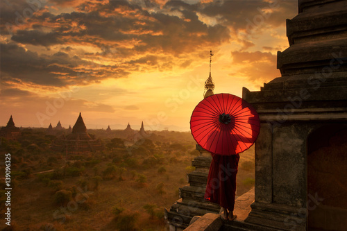 Novice Monk relaxing in ancient temple bagan on during sunset ,Bagan Myanmar,anc Poster
