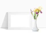 Beautiful iris flowers in vase and photo frame mockup