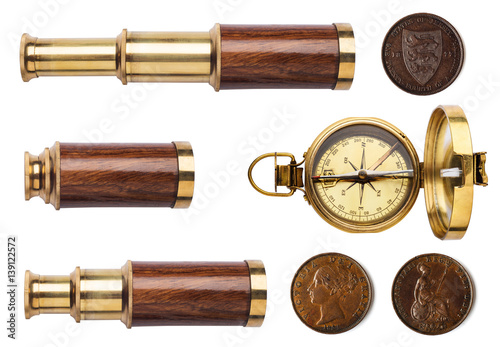 Keuken foto achterwand Schip Telescope, compass, and old coins isolated on white background.