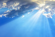 Sun light rays or beams bursting from the clouds on a blue sky. Spiritual religious background.