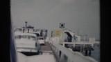 1962: light blue car entering a ferry terminal through a ramp JAMESTOWN VIRGINIA - 139151114