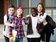 Group of teens posing outside school