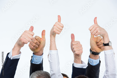 People showing thumbs up