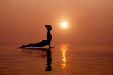 Yoga on the beach at sunset. Different correct asanas set in my portfolio