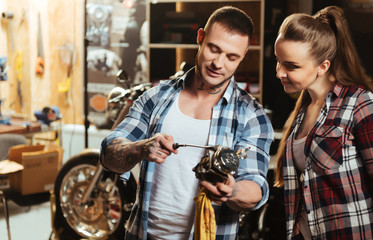 Positive delighted couple standing in the workshop