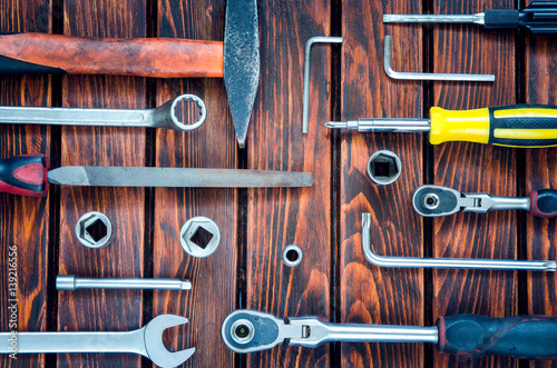 Tools on wooden table. Tools for DIY on a brown wooden background.