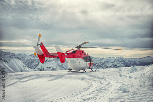 Juliste Helicopter mountain rescue service in the winter