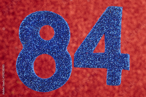 Poster Number eighty-four blue color over a red background. Anniversary.