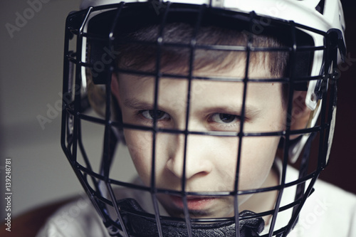 Little boy in the hockey helm. Emotions of child. Sport concept Poster