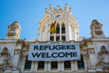 Madrid City Hall showing a banner supporting refugees