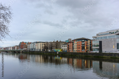 Apartment buildings along the river Liffey in Dublin, Ireland Poster