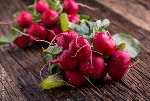 Radish. Fresh Radish. Red fresh radish. Fresh Vegetable on old oak table.