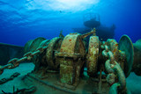 Heavy duty chain and winches that still exist on the forward deck of this sunken ship were used to raise the anchor. The vessel now lies beneath the sea in warm shallo water in Grand Cayman.