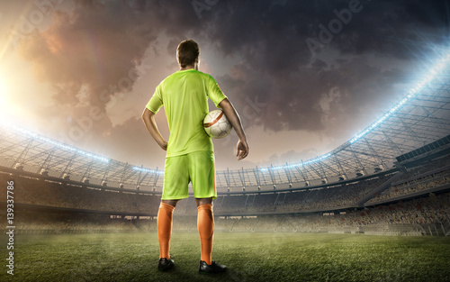 Fotobehang Voetbal Soccer stadium with soccer player