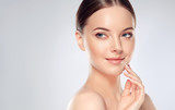 Beautiful Young Woman with Clean Fresh Skin touch own face . Facial treatment . Cosmetology , beauty and spa  - 139356742