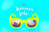 yellow sunglasses with reflection sunset at palm tree landscape scene with sea wave,Summer sale concept