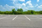 Fototapety Empty parking lot on blue sky background