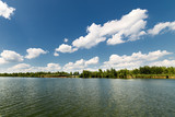 Clean lake and beautiful blue sky with clouds