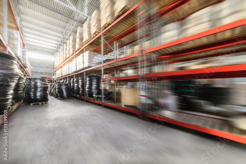 Long shelves with a variety of boxes and containers. Poster