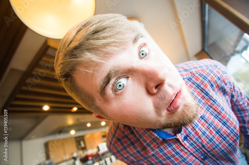 Poster Funny guy making faces at camera celebrating fools day