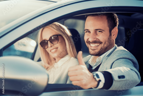 Sticker Young couple buying car at dealership center