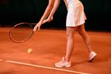 Legs of female tennis player on tennis court