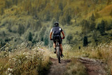 athlete cyclist mountainbiker downhill on trail