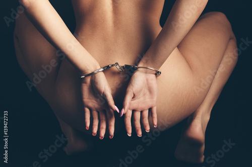 Nude Woman in Handcuffs in BDSM Bondage
