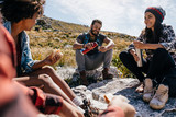 Group of hikers relaxing in field