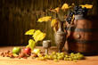 Wooden barrel, grapes and fresh apples on the table