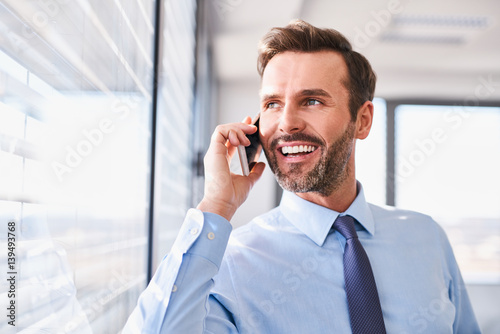 Fridge magnet Businessman talking on the phone in office looking out the window