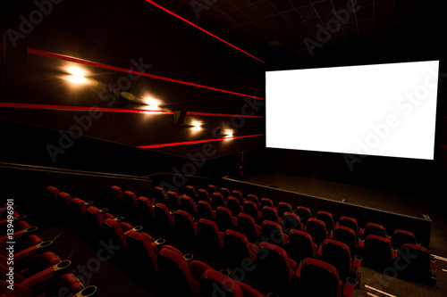 Cinema hall, white screen with copy space and empty armchairs Poster