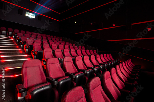 Cinema hall with red armchairs Poster