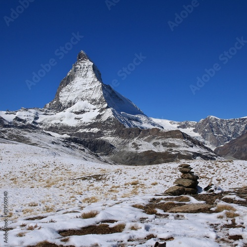 Poster Snow covered Matterhorn and cairn