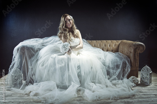Beautiful Blonde Bride Posing In Studio Poster