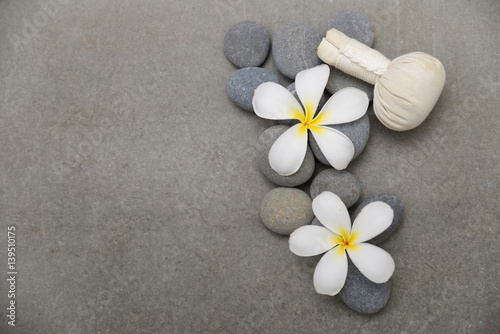Fotobehang Spa Two frangipani with herbal, ball on grey background.