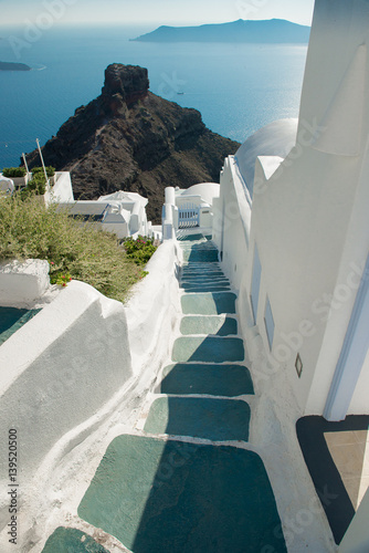 Architecture of  island of Santorini, the most romantic island in the world, Greece. Hotels in Santorini. Walking the streets of Fira summer day, Travel to Greece. Beautiful white exterior Santorini © NatBud