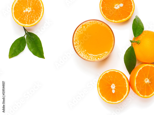 Oranges and juice, above view.