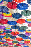 Colorful umbrellas on the ceiling of the largest mall in the world Dubai Mall UAE.