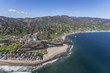 Aerial view of the Malibu Colony neighborhood, Malibu Lagoon and Surfrider Beach in Southern California.