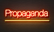 Постер, плакат: Propaganda neon sign on brick wall background