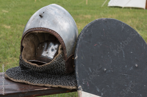 Poster Silver and Metallic Knight Helmet near Black Shield