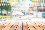 Fototapety Empty wooden table with party in garden background blurred.