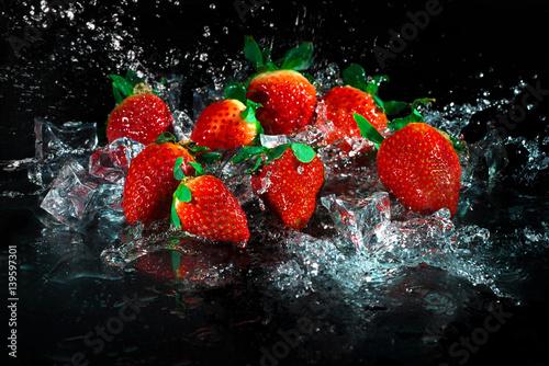 Strawberries in water splash