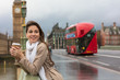 Woman Drinking Coffee on Westminster Bridge, Big Ben, London, England