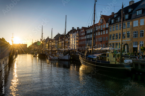 Nyhavn pier at sunset in the Old Town of Copenhagen, Denmark