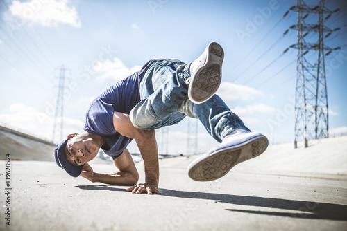 Breakdancers perfrming tricks Poster